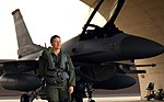 090312-F-9617W-032 Capt. Sarah Eccles walks away from a F-16 Falcon with her gear after a flight at Osan AB South Korea.JPG