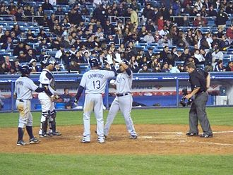 Carlos Peña - Peña is congratulated by Carl Crawford and Akinori Iwamura after hitting a three-run home run against the Yankees on April 4, 2008.