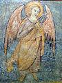 140 Santa Maria de Lluçà, àngel amb lliris.jpg