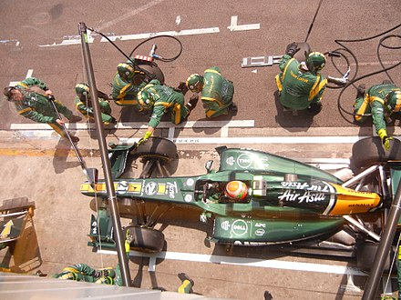 A Jarno Trulli pit-stop, for Lotus at the 2011 Brazilian Grand Prix 2011 Brazil GP - Lotus pitstop.jpg