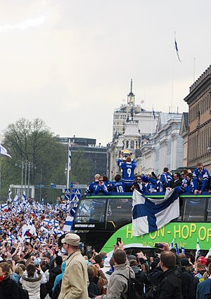 Finland men's national ice hockey team - Captain Mikko Koivu holds the trophy as the Finnish team arrives at Market Square in Helsinki to celebrate the title with about 100,000 fans.