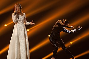 Slovenia in the Eurovision Song Contest 2015 - Marjetka Vovk with backing dancer at a dress rehearsal for the second semi-final