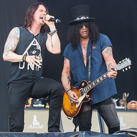 Slash and vocalist Myles Kennedy performing with the Conspirators in June 2015 2015 RiP Slash feat Myles Kennedy and the Conspirators - by 2eight - 8SC2803.jpg