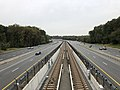 2018-10-26 11 40 51 View west along Virginia State Route 267 (Dulles Toll and Access Roads) and the Silver Line of the Washington Metro from the overpass for Virginia State Route 676 (Trap Road) in Wolf Trap, Fairfax County, Virginia.jpg