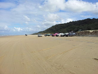 Off-roading - 4WDs at Fraser Island beach, Australia