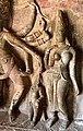 6th century Ravanaphadi cave temple, Parvati and Kartikeya next to Nataraja dancer, Aihole Hindu monuments Karnataka.jpg