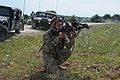 A Georgian soldier with Delta Company, 32nd Infantry Battalion aims his M4 carbine during a mission rehearsal exercise at the Joint Multinational Readiness Center in Hohenfels, Germany, Aug. 5, 2012 120805-A-UZ726-001.jpg