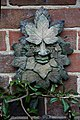 A Green Man wall ornament, Nuthurst, West Sussex, England.jpg
