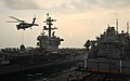 A U.S. Navy aircraft carrier gets replenished at sea. (40257115652).jpg
