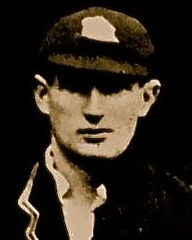 A headshot of a cricketer in a cap