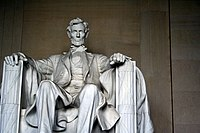 Abraham Lincoln sitting in his memorial.jpg