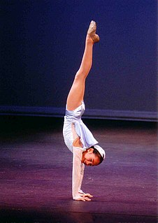 Handstand A hand-balancing posture in gymnastics and hatha yoga