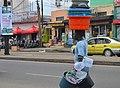 African Street vendor selling buckets.jpg
