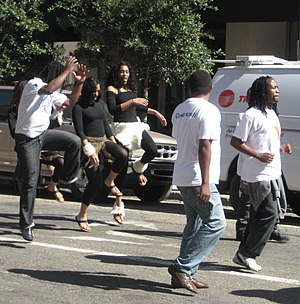 Second line (parades) - Exuberant dancing in the streets and sidewalks is part of the second line experience