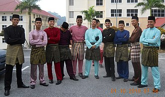 Malayisation - A typical Baju melayu assemble, worn together with the songket. Baju Melayu traces its origin to the 15th century Malacca Sultanate, and today is one of the most important symbol of Malay culture.