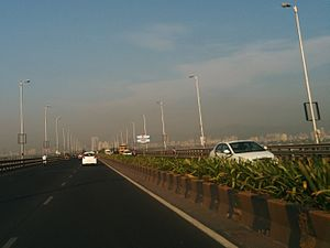 Airoli Bridge - Heading west on Airoli bridge (Mulund skyline in the background)