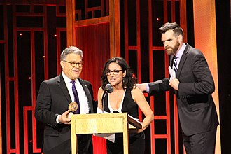 Louis-Dreyfus with her colleague Timothy Simons accepting the Peabody Award for Veep from Al Franken in May 2017 Al Franken Julia Louis-Dreyfus Timothy Simons - VEEP.jpg