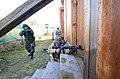 Albanian soldiers prepare to breach a building during a military adviser team (MAT) and police adviser team (PAT) training exercise at the Hohenfels Training Area, a part of the Joint Multinational Readiness 131216-A-LO967-009.jpg