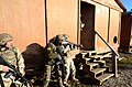 Albanian soldiers prepare to breach a building during a military adviser team (MAT) and police adviser team (PAT) training exercise at the Hohenfels Training Area, a part of the Joint Multinational Readiness 131216-A-LO967-010.jpg