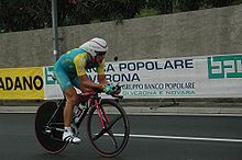 A cyclist riding a bike while in an aerodynamic position.