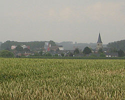 Brewery of Alken (left) and St-Aldegondis Church (right)