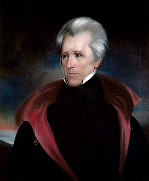 White-haired man with black coat
