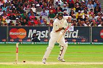 Andrew Symonds on the way to his maiden Test h...