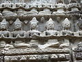 Angkor - Ta Prohm - 026 Row of Figures (8581961848).jpg