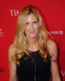 Ann Coulter smiling, with a red wallpaper behind her.