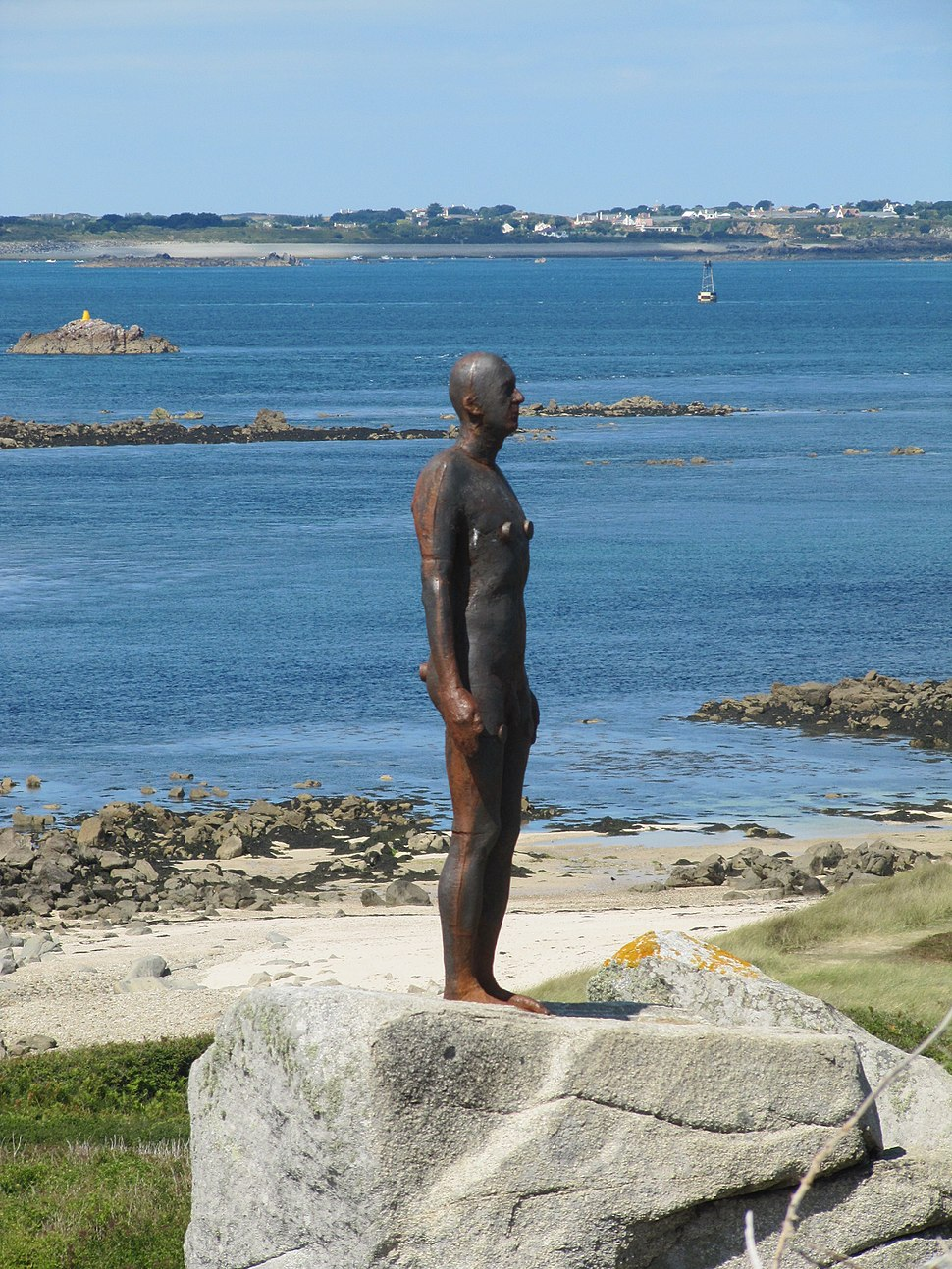 "Antony Gormley's ""Another Time XI"" on Herm - facing right"