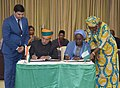 Arjun Ram Meghwal signing the Memorandum of Understanding on Trade and Investment with the Nigerian Minster of State for Industry, Trade and Investment, Ms. Aisha Abubakar.jpg