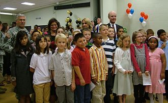 United States Army's Family and MWR Programs - Chief of Staff of the Army Gen. George W. Casey, Jr. and Secretary of the Army Pete Geren pose with Army family members after signing the Army Family Covenant at Fort Knox, Ky, 18 Oct. 2007. U.S. Army photo.