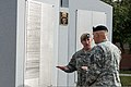 Army Lt. Col. Robert Harman, commander of the 1st Battalion, 75th Ranger Regiment, shows the Battalion's Fallen Heroes Memorial to Army Chief of Staff Gen. Raymond T. Odierno (right), during his visit to Hunter 121026-A-AO884-251.jpg