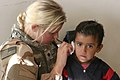 Army Spc Taryn Emery cleans the ear of an Iraqi child 061127-M-5585B-016.jpg