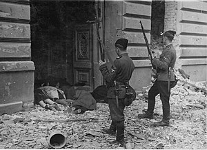 Hiwi (volunteer) - May 1943, Trawniki volunteers during the shooting action in the Warsaw Ghetto. Photo from Jürgen Stroop Report