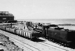 Comodoro Rivadavia Railway - A freight train powered by a Baldwin leaving Comodoro.