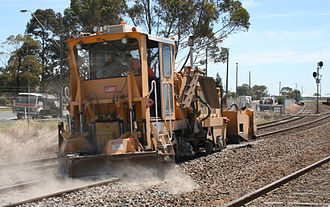 Track ballast - A ballast regulator shaping newly placed ballast