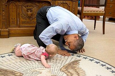Barack Obama crawling with Ella Rhodes.jpg