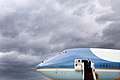 Barack Obama disembarks from Air Force One under a storm sky.jpg