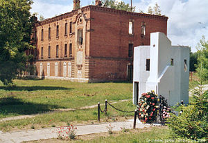Bereza Kartuska prison - Main prison building. The white structure on the right is a post-war Soviet monument, dedicated to victims of the camp.