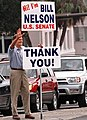 Bill Nelson with thank you sign after his election to United States Senate in 2000.jpg