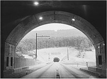 Black-and-white photo of second tunnel seen from end of the first