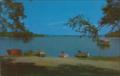 Boats on the shore of Kauneonga Lake, NY63 (8149567375).png