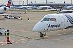 Bombardier Q400 NextGen Aurora Airlines parking in Narita.jpg
