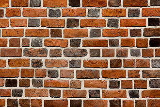Brick - A wall constructed in glazed-headed Flemish bond with bricks of various shades and lengths