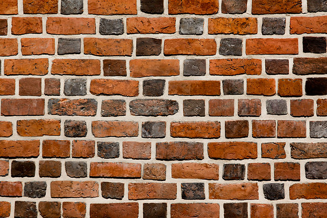 A wall constructed in glazed-headed Flemish bond with bricks of various shades and lengths; from Wikipedia