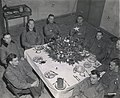 Brig. Gen. Anthony McAuliffe and his staff gathered inside Bastogne's Heintz Barracks for Christmas dinner Dec. 25th, 1944.jpg