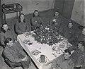 Brig. Gen. Anthony McAuliffe and his staff gathered inside Bastogne's Heintz Barracks for Christmas dinner Dec. 25th, 1944.jpg