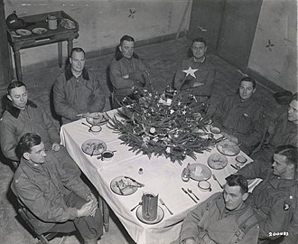 Anthony McAuliffe - Brigadier General Anthony McAuliffe and his staff gathered inside Bastogne's Heintz Barracks for Christmas dinner December 25th, 1944. This military barracks served as the Division Main Command Post during the siege of Bastogne, Belgium during World War II.