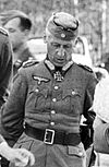 A man in military uniform wearing an Iron Cross at his neck.
